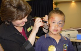 Young boy being seen by a health professional