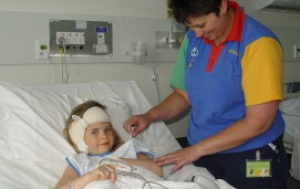 Young girl being seen by a nurse