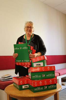 Olive Ruby with a pile of empty boxes she would love to have filled with Christmas cheer for less fortunate children overseas.