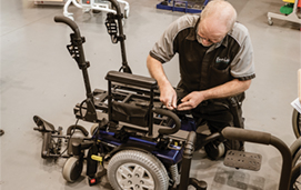 Technician working on wheelchair