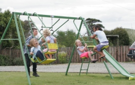 Photo of children on swings
